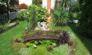 Как обустроить двор частного дома своими руками — фото