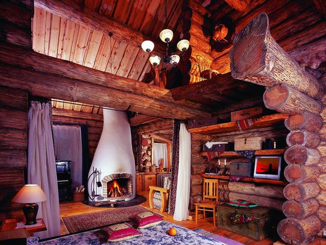 Интерьер бревенчатого дома можно сделать совершенно сказочным
